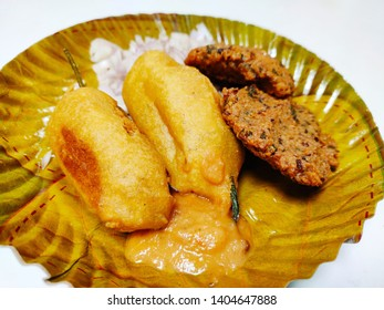 indian snacks of spicy mirchi bajii and masal vada (chana daal) recipe with onion chops and chatney