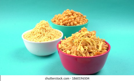 Indian Snacks, Traditional Indian deep fried salty dish called chivda or mixture or farsan made of gram flour and mixed with dry fruits and roasted nuts with salt, pepper, pulses, spice and green peas
