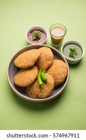 Indian special traditional fried food Kachori with tomato sauce and hot tea