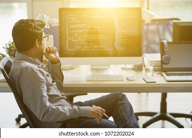 Indian It specialist working in sunny office