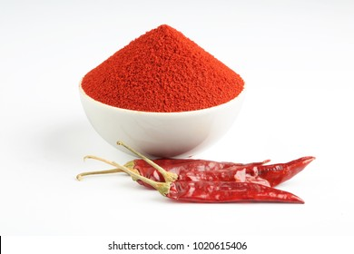 Indian spice Red chilli powder in yellow ceramic bowl