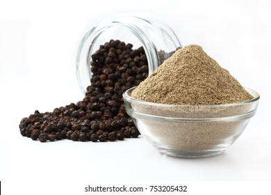 indian spices - black pepper powder,Black pepper corns scattered on white background and Black pepper Powder on Glass bowl isolated on white background.
