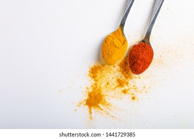 Indian spices Chilli and turmeric powder in spoon on white background