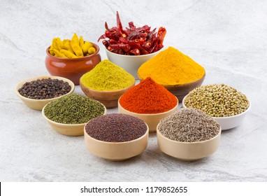 Indian Spices Collection Also Called Red Chili Powder, Turmeric Powder, Coriander Powder, Turmeric Stick, Dry Chili, Fenugreek, Black Pepper, Cumin, Mustard Seed, Mirchi, Haldi on Vintage Background