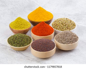 Indian Spices Collection Also Called Red Chili Powder, Turmeric Powder, Coriander Powder, Fenugreek, Cumin, Coriander Seeds, mustard Seed, Mirchi, Haldi, Methi, Dhaniya, Jeera on Vintage Background