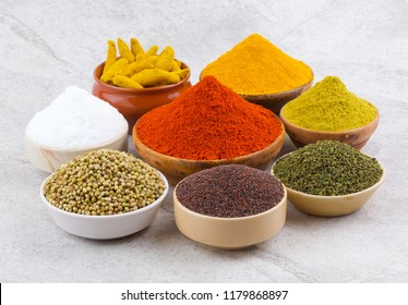 Indian Spices Collection Also Called Red Chili Powder, Turmeric Powder, Coriander Powder, Fenugreek, Mustard Seed, Salt, Turmeric Stick, Mirchi, Haldi, Dhaniya, Methi on Vintage Background