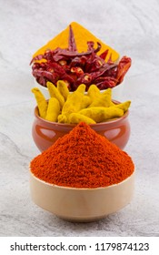 Indian Spices Collection Also Called Red Chili Powder, Turmeric Powder, Turmeric Stick, Dry Chili, Mirchi, Haldi or Dhaniya on Vintage Background