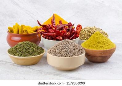 Indian Spices Collection Also Called Turmeric Powder, Coriander Powder, Turmeric Stick, Dry Chili, Fenugreek, Cumin, Coriander Seeds, Mirchi, Haldi, Methi, Dhaniya, Jeera on Vintage Background
