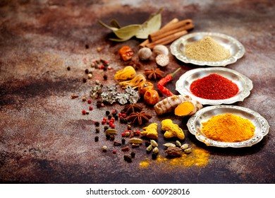 Indian Spices and herbs in old silver bowls.