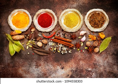 Indian spices and seasonings on a concrete background, top view, flat lay