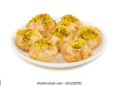 Indian Spicy Chaat Item Sev Puri Stuffed With Potato, Sev Namkeen, Coriander, Chutney isolated on White Background. It is a Most Popular Snack of Mumbai, Maharashtra