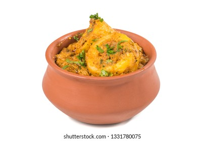 Indian spicy curry Kashmiri Dum Aloo Isolated on white background