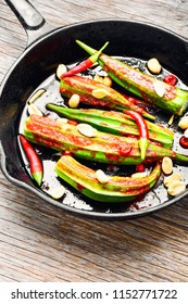 Indian spicy food from baked okra with spices.Vegetarianism