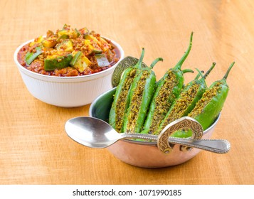Indian Spicy Green Chilli Pickle with Mango Pickle Also Know as Mirchi Ka Achaar or Loncha Marinated in Mustard Seeds And Mustard Oil
