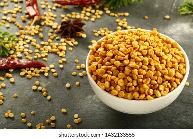 Indian spicy snacks- chat pata dal, namkeen,bujia, deep fried bangal gram with spices.