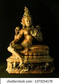 Indian statue bronze with Tara Goddess on black background