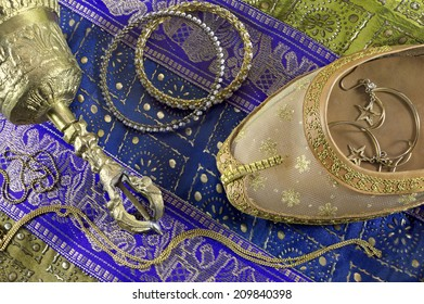 Indian still life with belly dance shoe and jewelry