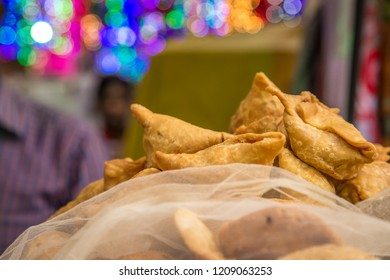 Indian street food vendor sell Fresh Samosa  and kachoris,a popular variety in a busy road of Delhi