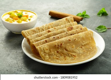 Indian street  foods- whole wheat chapati or chapathi with vegetable curry.