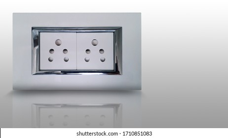 Indian style electric socket with auto shutter and shiny steel strip for wall fitting made with bakelite plastic insulator and consist of two socket -isolated image