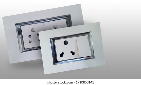 Indian style electric socket with auto shutter and shiny steel strip for wall fitting made with bakelite plastic insulator and consist of a socket and a switch -isolated image