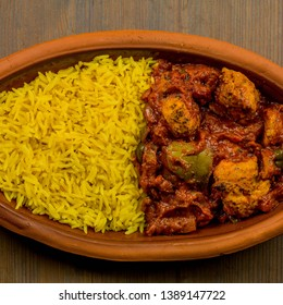 Indian Style Food of Spicy Chicken Curry And  Fragrant Yellow Pilau Rice, Square Format Flat Lay Composition, With No People