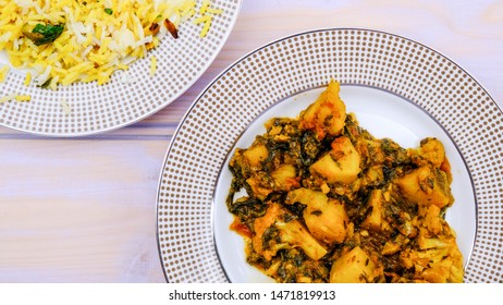Indian Style Vegetarian Aloo Gobi Saag , Potato, Cauliflower and Spinach in a Spicy Sauce With Rice