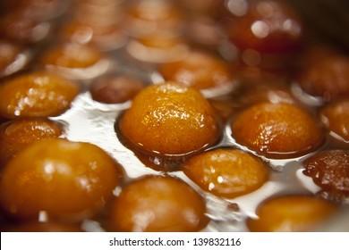 """Indian sweet dish called """" gulab jamun """"."""