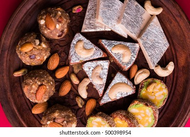 Indian sweet dry fruits and nuts barfi / laddo / mithai