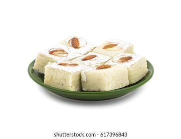 Indian Sweet Food Badam Barfi Also Know As Mithai, barfee, Mawa Barfi, Mava barfi, Almond Sweet, khoya Burfi Indian Popular Sweet Made up of Coconut, Mawa, Milk and Sugar isolated on white background