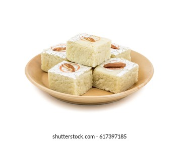 Indian Sweet Food Badam Barfi Also Know As Mithai, barfee, Mawa Barfi, Mava barfi, Almond Sweet, khoya Burfi Indian Popular Sweet Made up of Coconut, Mawa, Milk and Sugar isolated on white background