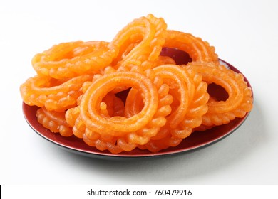 Indian Sweet Food Imarti Also Know as Amriti, Omriti, Jahangir, Jalebi, Jaangiri. It is Mde by Deep-Frying Vigna Mungo Flour Batter in a Kind of Circular Flower Shape.