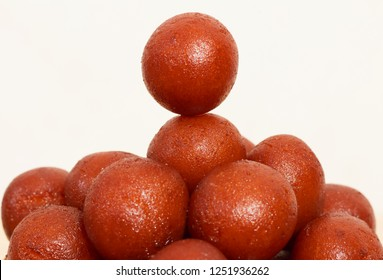 Indian Sweet Gulab Jamun  is a Syrupy Dessert Popular in India.
