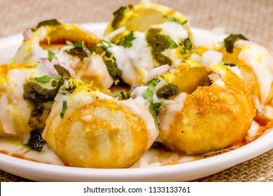 Indian Sweet And Spicy Chaat item Dahi Puri Also Called Dahi Batata Puri, Golgappe, Dahi Bhalle, Gol Gappa or Dahipuri Stuffed With Potato, Yogurt, Sev, Coriander, Chutney
