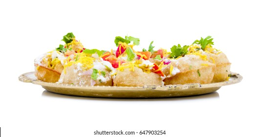 Indian Sweet And Spicy Chaat item Dahi Puri Also Called Dahi Batata Puri, Golgappe, Dahi Bhalle, Gol Gappa or Dahipuri Stuffed With Potato, Yogurt, Sev, Coriander, Chutney isolated on White Background