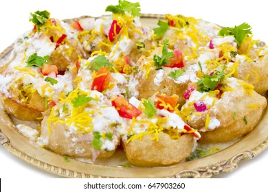 Indian Sweet And Spicy Chaat item Dahi Puri Also Called Dahi Batata Puri, Golgappe, Dahi Bhalle, Gol Gappa or Dahipuri Stuffed With Potato, Yogurt, Sev, Coriander, Chutney isolated on White Background