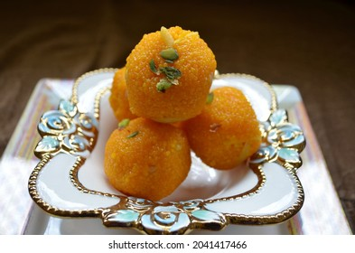 Indian sweetmeat Laddoo made from gram flour, sugar and fat. Indian dessert. Tasty, sweet and soft. Festivity.