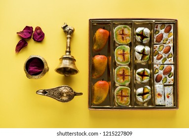 Indian sweets and Mithai in box for Diwali festival, flat lay, top view