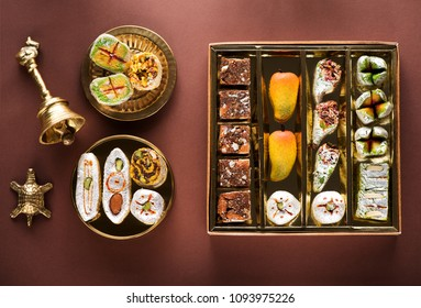 Indian sweets and Mithai in a box and a plate. Diwali festival concept, flat lay, top view