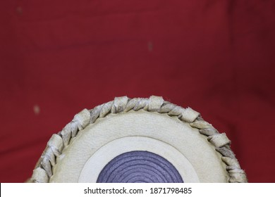 Indian tabla drums on a red background. close up