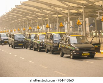 Indian taxis waiting for passengers outside Delhi Airport, India