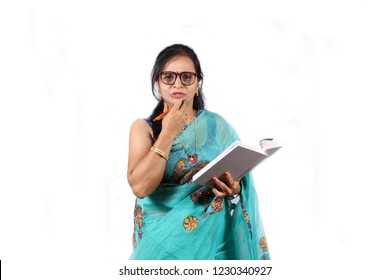 An Indian teacher in Blue Saree asking a question to students, on white studio background.