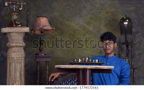 indian-teen-boy-sitting-front-600w-17741