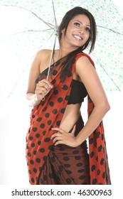 Indian teenage girl holding umbrella