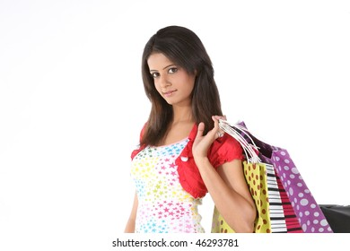 Indian teenage girl returning with shopping bags