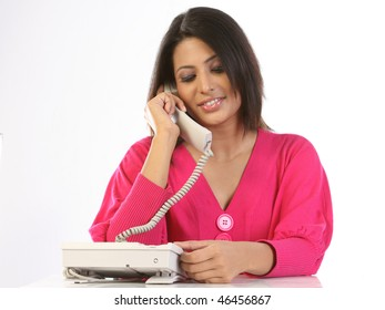 Indian teenage girl talking over telephone receiver