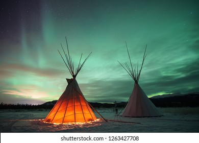 Indian Tipies under the northern lights in Whitehorse, Yukon (Canada)