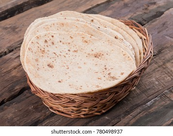 Indian Traditional Cuisine Chapati Also Know as Roti, Fulka, Paratha, Indian Bread, Flatbread, Whole Wheat Flat Bread, Chapathi, Wheaten Flat Bread, Chapatti, Chappathi or Kulcha on Wooden Background