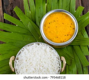 Indian Traditional Cuisine Dal Fry or Rice Also Know as Dal Chawal, Daal Chawal, Dal Rice, Whole Yellow Lentil with Rice or Dal Tadka, Daal Fry Served with Rice on Wooden Background