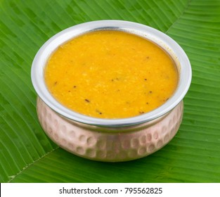 Indian Traditional Cuisine Dal Fry Also Know as Plain Dal, Daal Tadka, Dal Curry, Daal Fry, Dal or Daal Tarka Served in a Bowl on Banana Leaf
